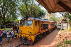Passengers at railway station waiting for arriving Vintage diese. Kanchanaburi, Thailand - February, 18, 2018: Passengers at railway station waiting for arriving Royalty Free Stock Image