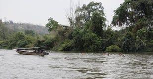 Tourists float in lifejackets on the river Kwai. Kanchanaburi,Thailand- February 19,2018: Tourists float in lifejackets on the river Kwai royalty free stock photo