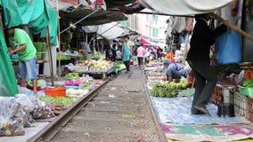KANCHANABURI, THAILAND - FEBRUARY 2014: Train passing through market stock video
