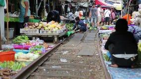 KANCHANABURI, THAILAND - FEBRUARY 2014: Train passing through market stock footage