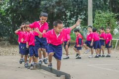 KANCHANABURI THAILAND - FEBRUARY 23 : Unidentified kids exercise. In the morning before class on february 23,2018 at Wat Krang Thong School in Kanchanaburi Stock Photography