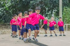 KANCHANABURI THAILAND - FEBRUARY 23 : Unidentified kids exercise. In the morning before class on february 23,2018 at Wat Krang Thong School in Kanchanaburi Royalty Free Stock Image