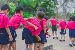 KANCHANABURI THAILAND - FEBRUARY 23 : Unidentified kids exercise. In the morning before class on february 23,2018 at Wat Krang Thong School in Kanchanaburi Stock Images