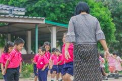 KANCHANABURI THAILAND - FEBRUARY 23 : Unidentified kids exercise. In the morning before class on february 23,2018 at Wat Krang Thong School in Kanchanaburi Stock Photos