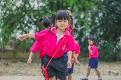 KANCHANABURI THAILAND - FEBRUARY 23 : Unidentified kids exercise. In the morning before class on february 23,2018 at Wat Krang Thong School in Kanchanaburi Royalty Free Stock Photos