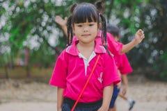 KANCHANABURI THAILAND - FEBRUARY 23 : Unidentified kids exercise. In the morning before class on february 23,2018 at Wat Krang Thong School in Kanchanaburi Stock Photo