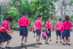 KANCHANABURI THAILAND - FEBRUARY 23 : Unidentified kids exercise. In the morning before class on february 23,2018 at Wat Krang Thong School in Kanchanaburi Royalty Free Stock Photography