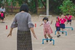 KANCHANABURI THAILAND - FEBRUARY 23 : Unidentified kids exercise. In the morning before class on february 23,2018 at Wat Krang Thong School in Kanchanaburi Royalty Free Stock Photo