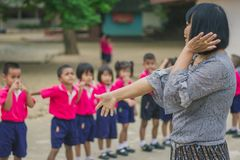 KANCHANABURI THAILAND - FEBRUARY 23 : Unidentified kids exercise. In the morning before class on february 23,2018 at Wat Krang Thong School in Kanchanaburi Stock Image