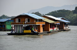Kanchanaburi, Thailand: Houseboats on River Kwai. A small flotilla of houseboats floating down the River Kwai provide both tourists and the locals views of the Stock Image