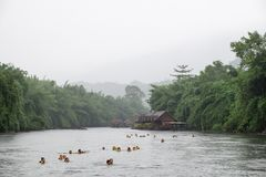 Kanchanaburi,Thailand - Jul 06 2016 : Tourists staying at the resort playing activity floating swim in river kwai stock photography