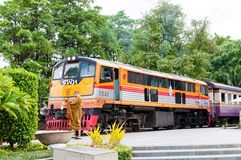 Kanchanaburi, Thailand - May 23, 2014: Train ready to cross the bridge over the river Kwai in Kanchanaburi province, Thailand. Royalty Free Stock Images