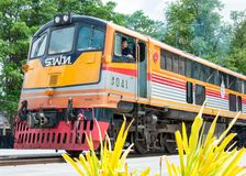 Kanchanaburi, Thailand - May 23, 2014: Train ready to cross the bridge over the river Kwai in Kanchanaburi province, Thailand. Stock Image