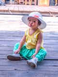 Kanchanaburi Thailand - October 28, 2017: Tourist Little girl wearing traditional thai dress in the old market at Muang Mallika. The new tourist attraction for stock photo