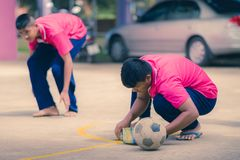 KANCHANABURI THAILAND - SEPTEMBER 20 : Unidentified students he. Lp to build a sepak takraw field border on the cement floor on September 20,2018 at stock image