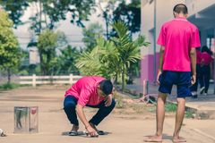 KANCHANABURI THAILAND - SEPTEMBER 20 : Unidentified students he. Lp to build a sepak takraw field border on the cement floor on September 20,2018 at royalty free stock photo