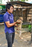 Kanchanaburi, Thailand: Trainer with Monkey Royalty Free Stock Photos