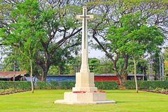 Cross At Kanchanaburi War Cemetery, Kanchanaburi, Thailand. Kanchanaburi War Cemetery is the main prisoner of war cemetery for victims of Japanese imprisonment royalty free stock photos