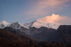 Kanchenjunga from a distance. Kanchenjunga rises above the Himalayas as sunrise Royalty Free Stock Photo