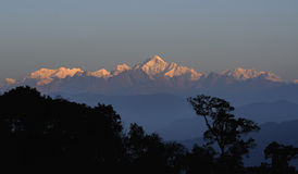 Kanchenjunga mountain range -sunlit in the morning, Sikkim. Kanchenjunga mountain range in the morning, Sikkim Royalty Free Stock Image