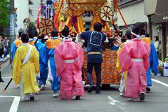 Kanda festival matsuri participants portable shrine. Participants of the Kanda festival, Tokyo pushing a festival float carrying a mikoshi portable shrine stock photo