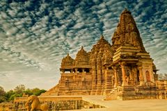 Kandariya Mahadeva Temple, Khajuraho, India-UNESCO world heritage site. Beautiful image of Kandariya Mahadeva temple, Khajuraho, Madhyapradesh, India with blue royalty free stock photo