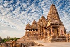 Kandariya Mahadeva Temple, Khajuraho, India-UNESCO world heritage site. Beautiful image of Kandariya Mahadeva temple, Khajuraho, Madhyapradesh, India with blue royalty free stock image
