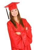 Kandidat: Vuxen student i rött lock och kappa royaltyfri foto