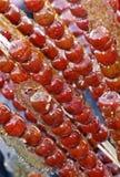 Kandierte Haws auf einem Steuerknüppel. Stockfoto