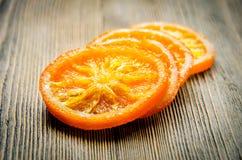 Kandierte Orangen auf Tabelle Lizenzfreie Stockfotos