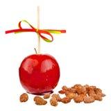Kandierter Apfel mit Mandeln Stockbilder
