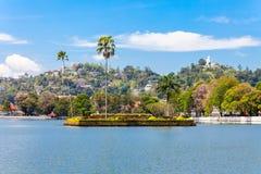Kandy Lake, Sri Lanka. Island with palms on the Kandy Lake in Kandy city, Sri Lanka royalty free stock image