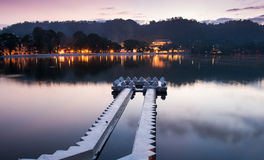 Kandy Lake at Sunrise, Kandy, Sri Lanka, Asia. Kandy Lake and the Temple of the Sacred Tooth Relic Sri Dalada Maligawa at Sunrise, Kandy, Sri Lanka, Asia stock photo