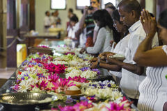 KANDY, SRI LANKA - DECEMBER 01:, 2016: Temple Of The Sacred Toot. H RelicThe inside view. People bring flowers to the Temple. Kandy, Sri Lanka Royalty Free Stock Photo
