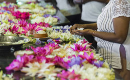 KANDY, SRI LANKA - DECEMBER 01:, 2016: Temple Of The Sacred Toot. H RelicThe inside view. People bring flowers to the Temple. Kandy, Sri Lanka Royalty Free Stock Image