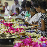 KANDY, SRI LANKA - DECEMBER 01:, 2016: Temple Of The Sacred Toot. H RelicThe inside view. People bring flowers to the Temple. Kandy, Sri Lanka Stock Images