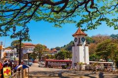 Kandy, Sri Lanka - 5 February 2017: City traffic, Clock tower in downtown Kandy royalty free stock photo