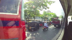 KANDY, SRI LANKA - FEBRUARY 2014: View of traffic from moving vehicle. stock video
