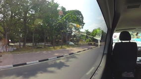 KANDY, SRI LANKA - FEBRUARY 2014: View of traffic from moving vehicle. stock footage