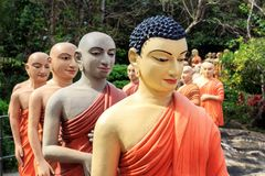 Statues of Buddhist monks standing in line to worship the Buddha. Kandy, Sri Lanka - January 9, 2018. Statues of Buddhist monks standing in line to worship the Royalty Free Stock Photos