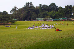 Kandy, Sri Lanka, october 21, 2011: Students walk through the park Royalty Free Stock Photo