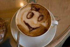 kanelbrun kaffekopp Arkivbild