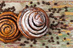 Kanelbulle with coffee beans. stock photo
