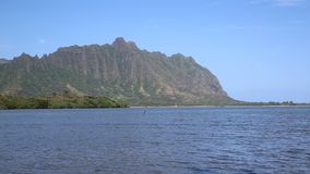 Kaneohe Bay with Kualoa Ranch cliffs stock video footage