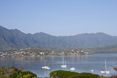 Kaneohe Bay, Oahu, Hawaii. Landscape view of Kaneohe Bay, Oahu, Hawaii with sailboats and mountains in the background Royalty Free Stock Photography