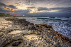 Oahu Rocky Shore Sunset Stock Image