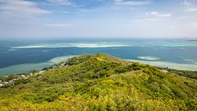 Kaneohe Sandbar Seascape. Panoramic landscape view of the Kaneohe sandbar from a pillbox hike near the tropical, blue paradise waters of Oahu, Hawaii, USA Royalty Free Stock Photo