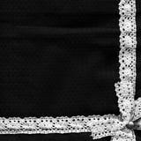 Kanfastextur som täckas av svart abc-bok Linnebakgrund Royaltyfri Fotografi