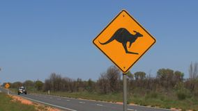 A kangaroo cross road sign 4wd car passing by stock video footage