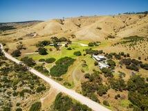 Kangaroo Island rural area aerial view - gravel road, yellow hil Royalty Free Stock Images